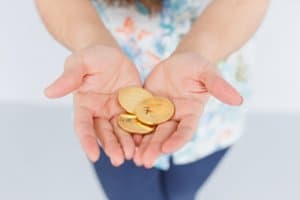 Bitcoin coins in woman hands. Close up view