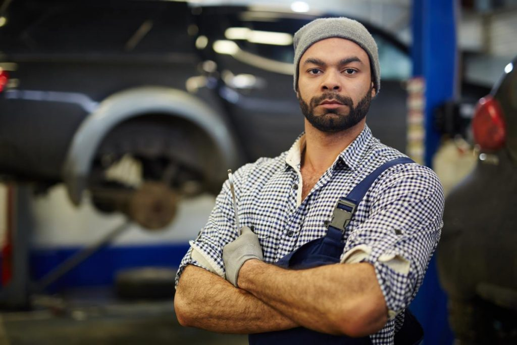 Owner of car service looking at camera